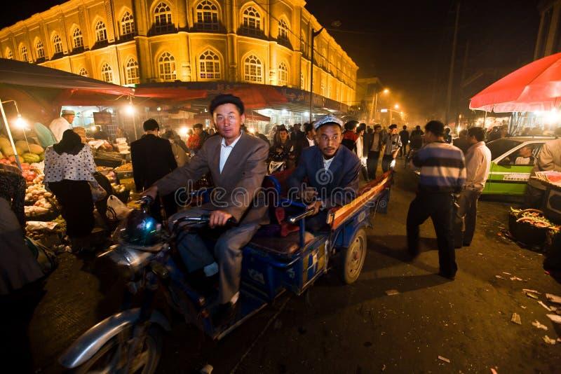 Taxi de la motocicleta en las calles de Kashgar fotos de archivo libres de regalías