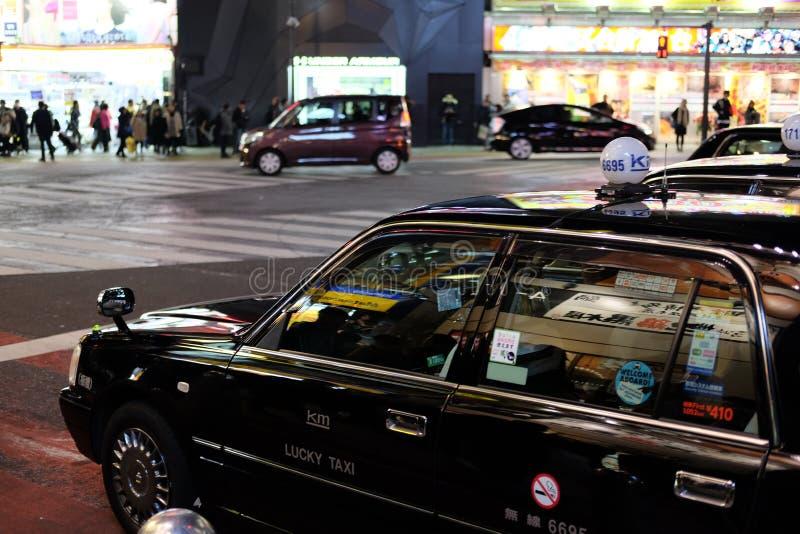 Taxi de la noche foto de archivo libre de regalías