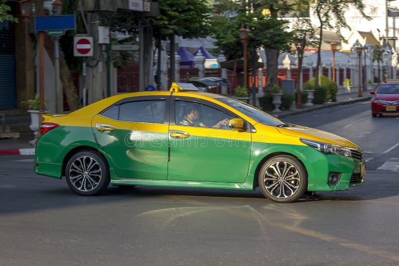 Taxi dei funzionamenti della Tailandia sulla via fotografia stock libera da diritti