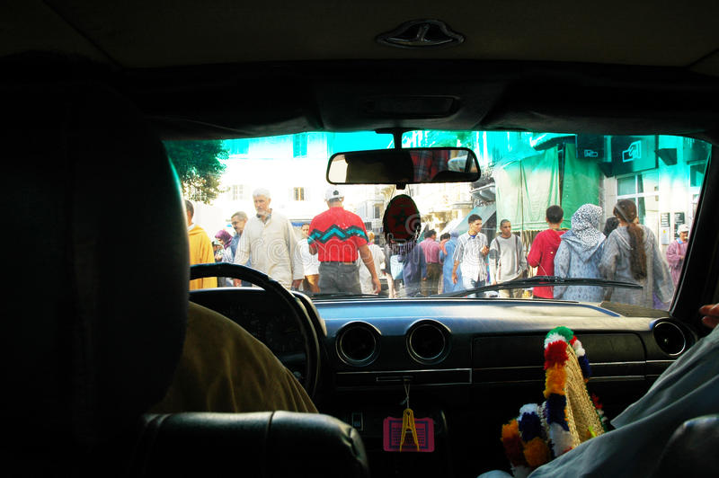Taxi Driver Crossing Busy Street - Morocco, Inside Car View stock photos