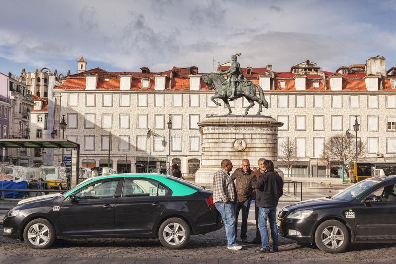 Taxi Drivers in Praca de Figueira Lisbon Portugal. 27 February 2018: Lisbon, Portugal - Taxi drivers chat as they wait for customers in Figueira Square stock photography