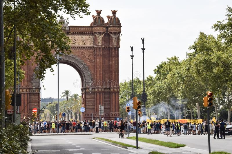 Barcelona, Spain - July 25, 2018: Taxidrivers demonstrate against injustice with posters, flags and smoke bomb. Taxi drivers protest against too many licenses stock photos