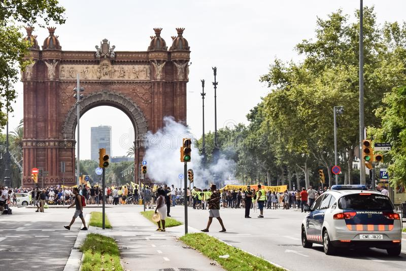 Barcelona, Spain - July 25, 2018: Taxidrivers demonstrate against injustice with posters, flags and smoke bomb. Taxi drivers protest against too many licenses royalty free stock image