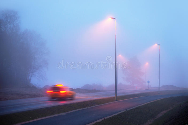 Download Taxi in fog stock photo. Image of taxi, road, twilight - 27498604