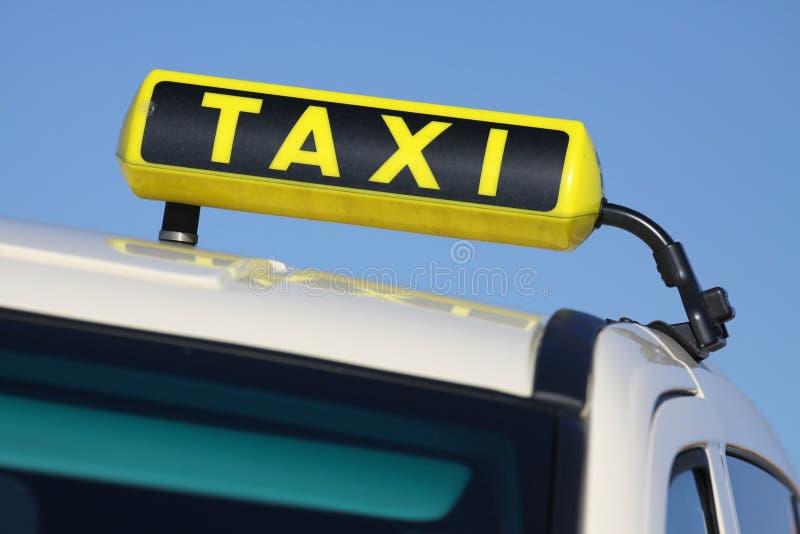 Taxi. German taxi sign against blue sky stock photos