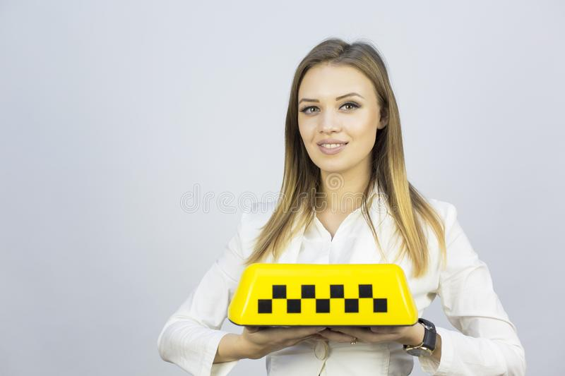 Taxi - girl dispatcher and other materials on the topic of taxi. royalty free stock photos