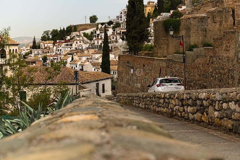 Taxi going down in an old town stock photography