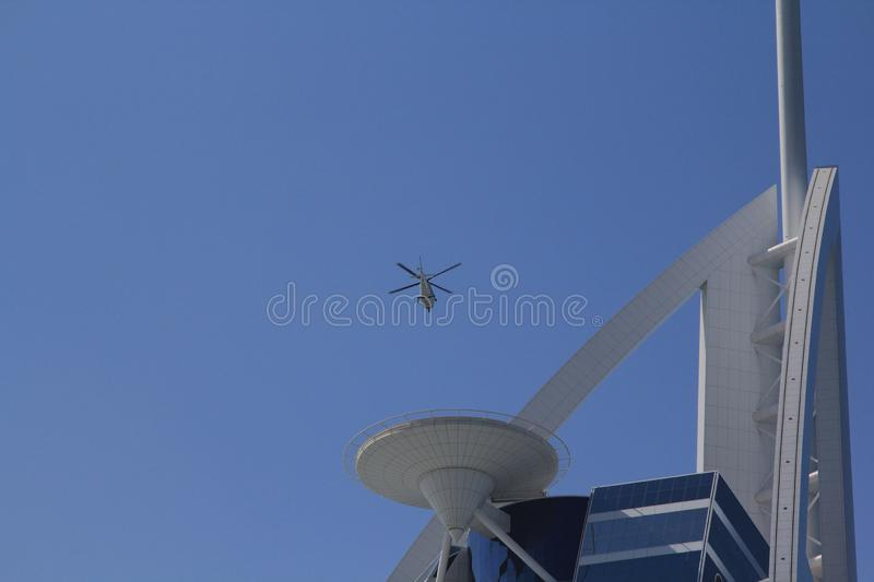 Taxi Helicopter transfer landing on the roof top of tower building. stock photo