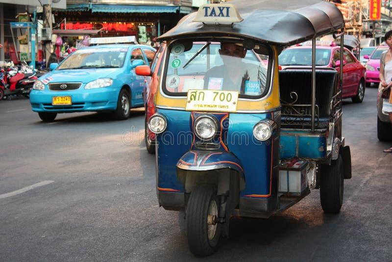 Taxi Moto. Three-wheeled vehicle. Colored cars. Bangkok royalty free stock image