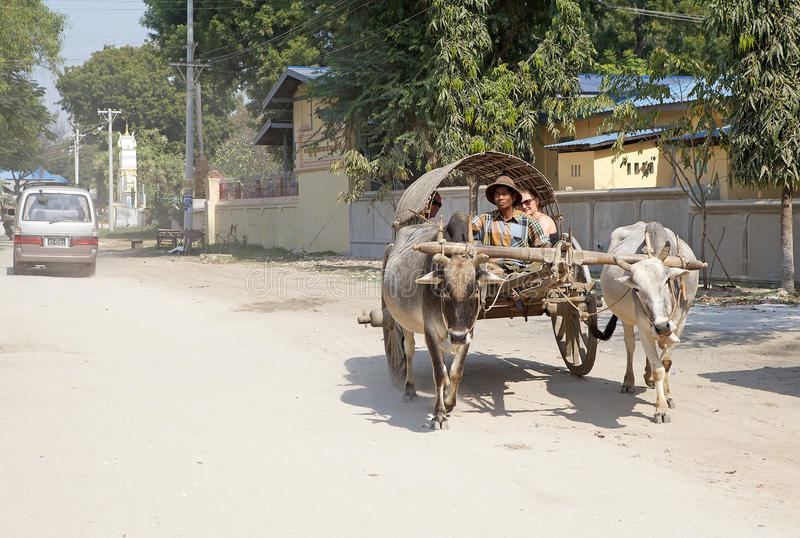 Taxi Myanmar. Traditional burmese carriage taxi along the street at Mingun, Myanmar royalty free stock image
