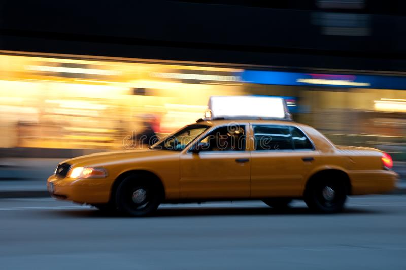 Taxi at night, with copyspace stock photography