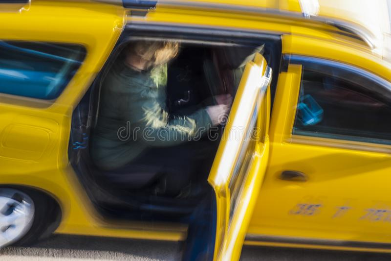 Taxi passenger`s coming out royalty free stock image