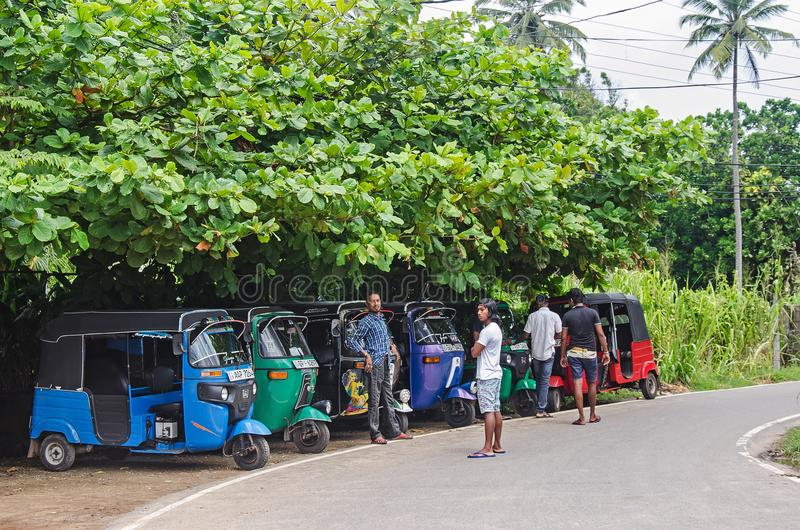 A taxi rank in Sri Lanka. With local drivers stock image