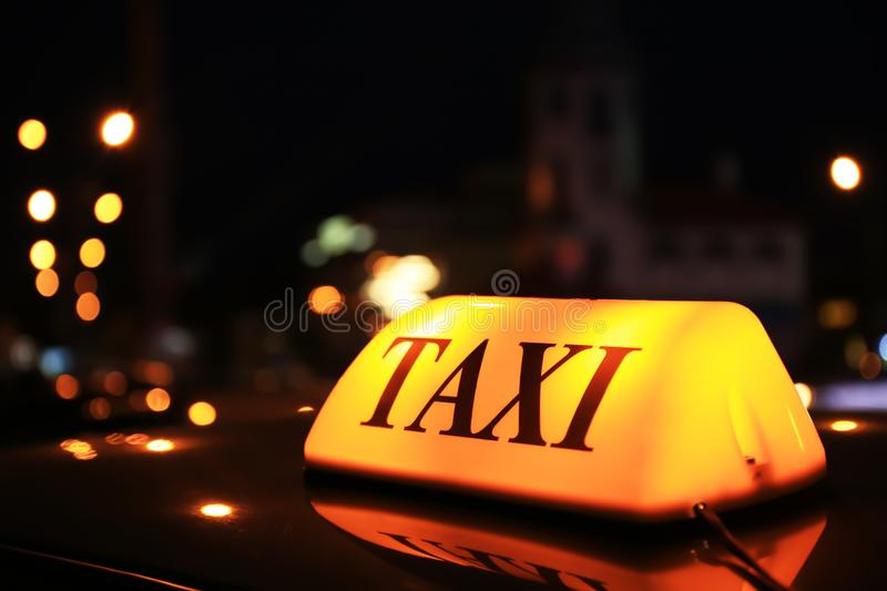 Taxi roof top light at night stock image