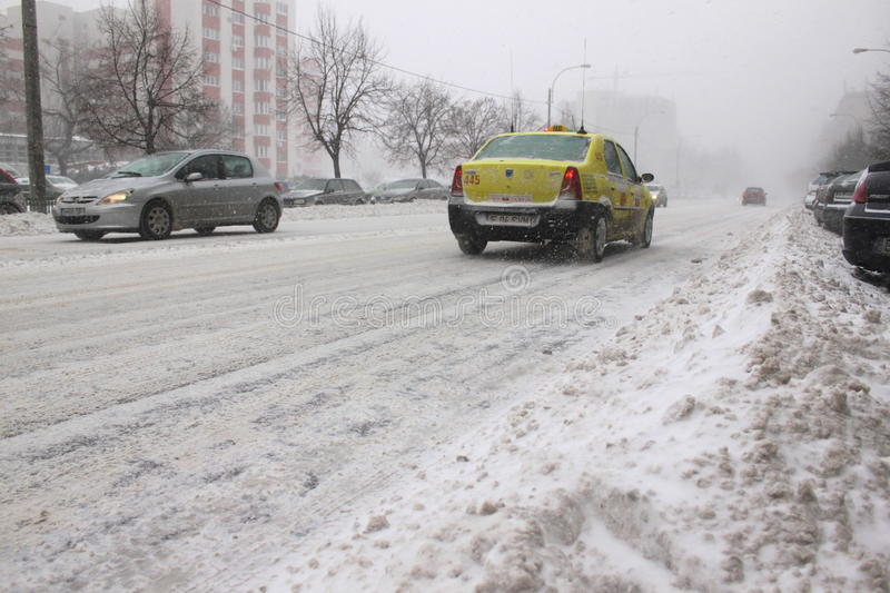 Taxi Runing On Blizzard Editorial Photography