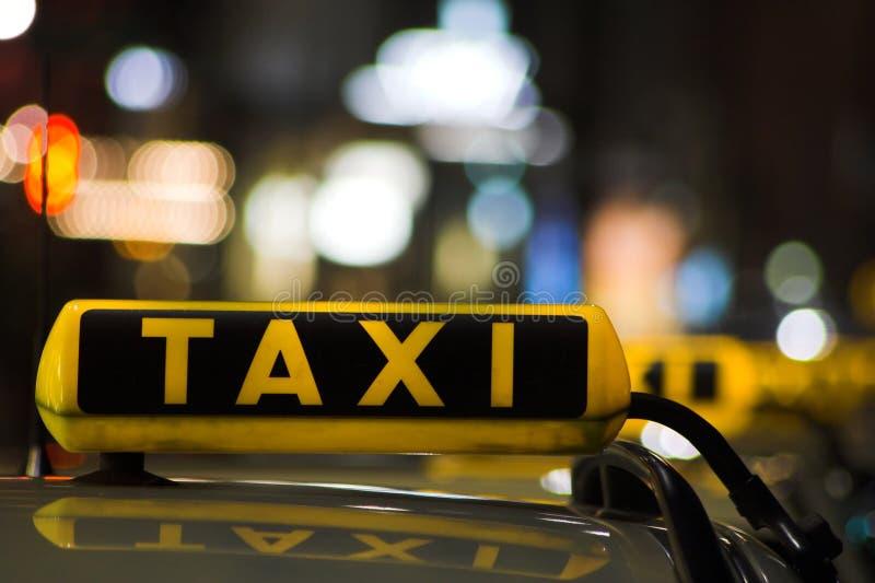 Taxi sign. Cu of taxi sign at night