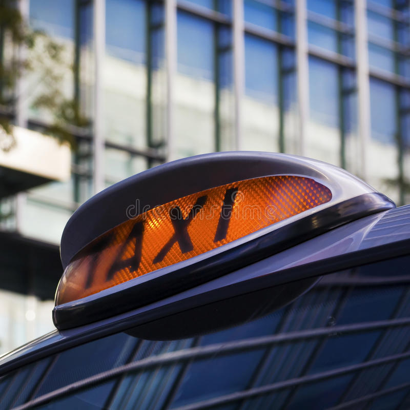 Taxi sign. On Cab in Canary Wharf, London royalty free stock photography