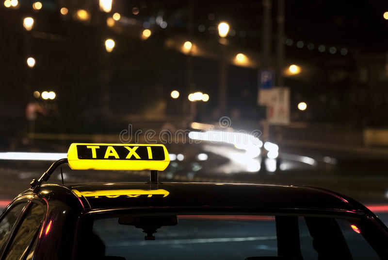 Taxi sign at night royalty free stock image