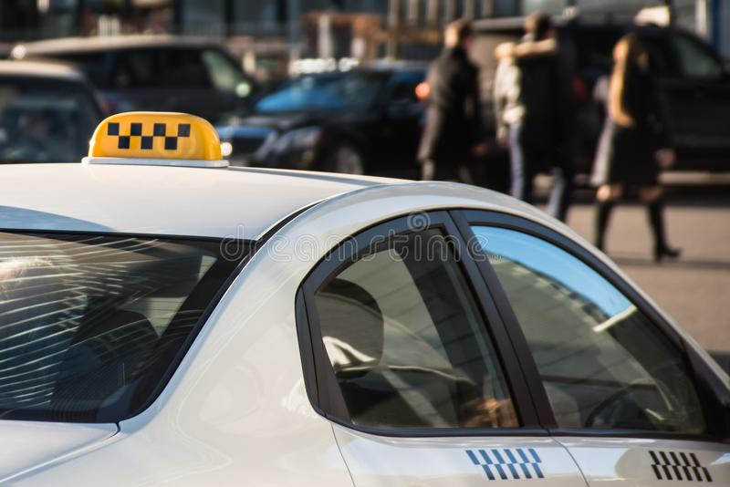 Taxi sign on top of a car roof royalty free stock image