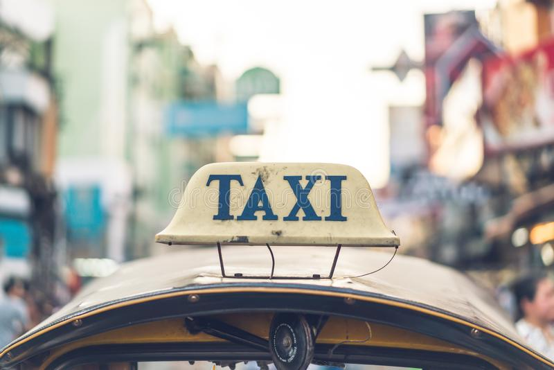 Taxi sign on top of the tuk-tuk royalty free stock photos