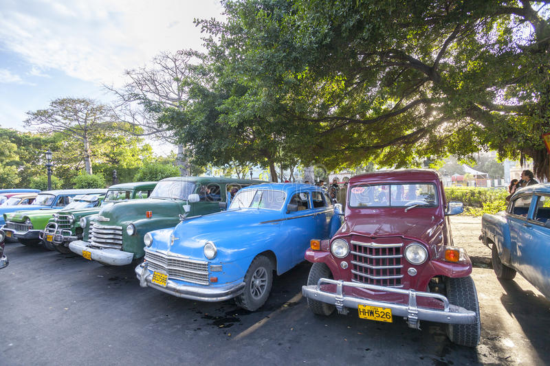 Taxi station in Havana. Most of the old American cars in Havana are still in function as taxi cars. Problems of the spare parts they solve with using of spare stock images