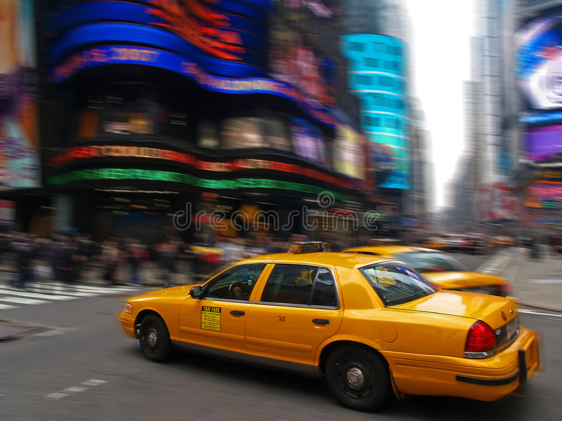 Taxi in times square. In New York City, motion blur stock photography
