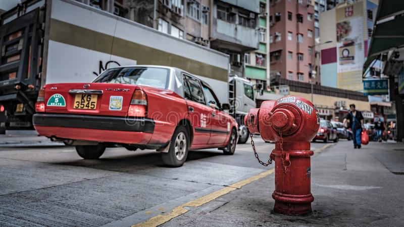 Taxi Service And Fire Hydrant Connection Point On Street. Taxi Transportation Service And Fire Hydrant Connection Point On Street In Hong Kong royalty free stock photos