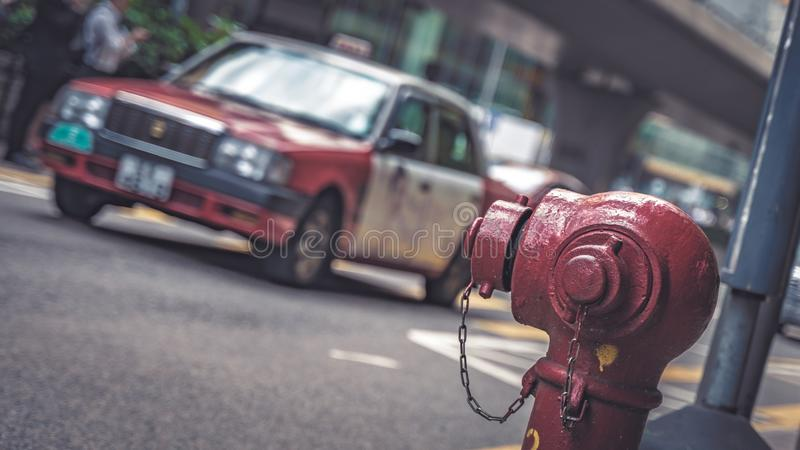 Taxi Service And Fire Hydrant Connection Point On Street. Taxi Transportation Service And Fire Hydrant Connection Point On Street In Hong Kong royalty free stock image