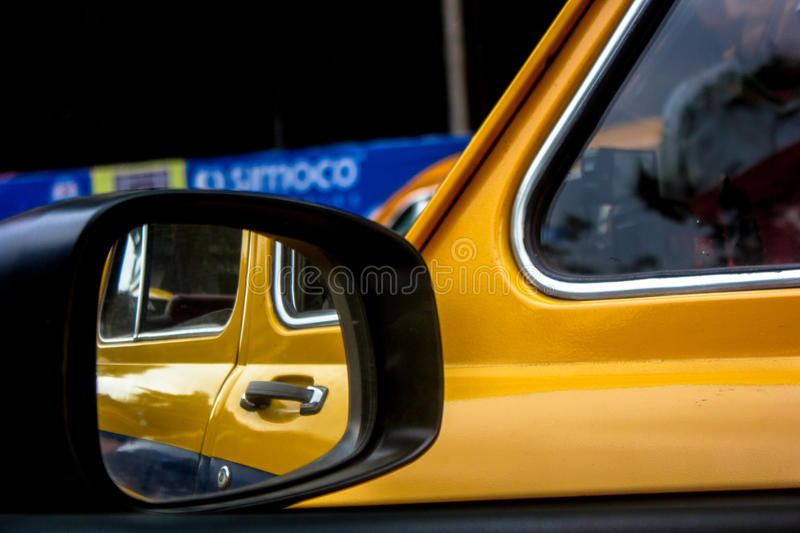 Taxi travel Kolkata. Yellow Ambassador cars are iconic, production has is stopped but now it is iconic symbol of Kolkata stock image