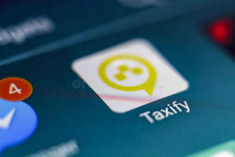 Taxify app on smartphone screen royalty free stock photos