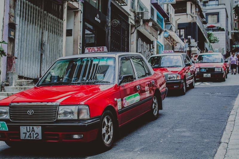 Taxis στην οδό στο Χονγκ Κονγκ στοκ εικόνα