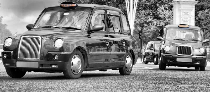 Taxis en la ciudad de Londres foto de archivo libre de regalías