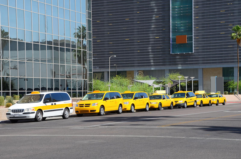 Taxis lined up for fares stock photography
