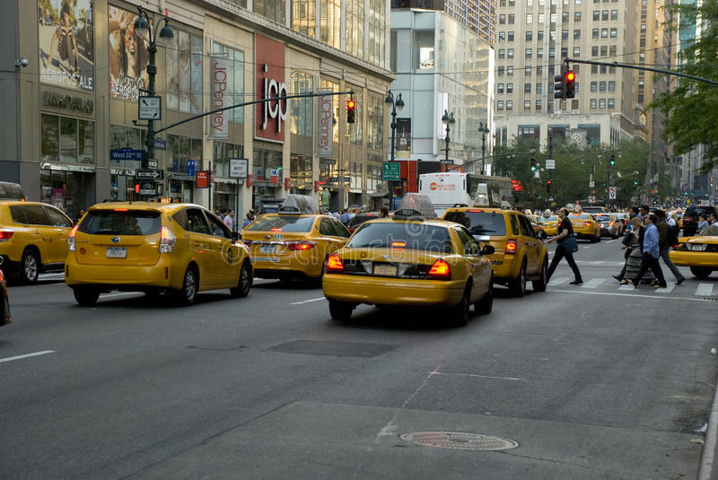 Taxis - New York yellow cabs on street with red light stock photos
