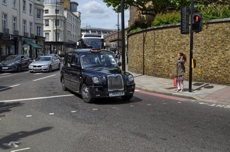 Taxis van Londen, genoemd cabines stock foto