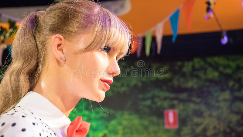 Taylor Swift. Side and close up view of the wax statue of the American singer-songwriter and actress Taylor Swift . Photo taken at the Madame Tussauds museum at stock photo