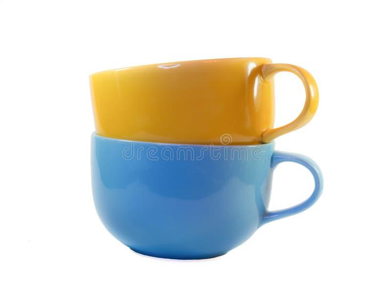 Taza amarilla y azul grande del vistazo de la sopa fotografía de archivo