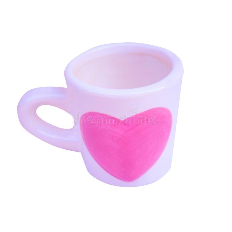 Taza blanca vacía con el corazón rosado aislado en el fondo blanco fotos de archivo