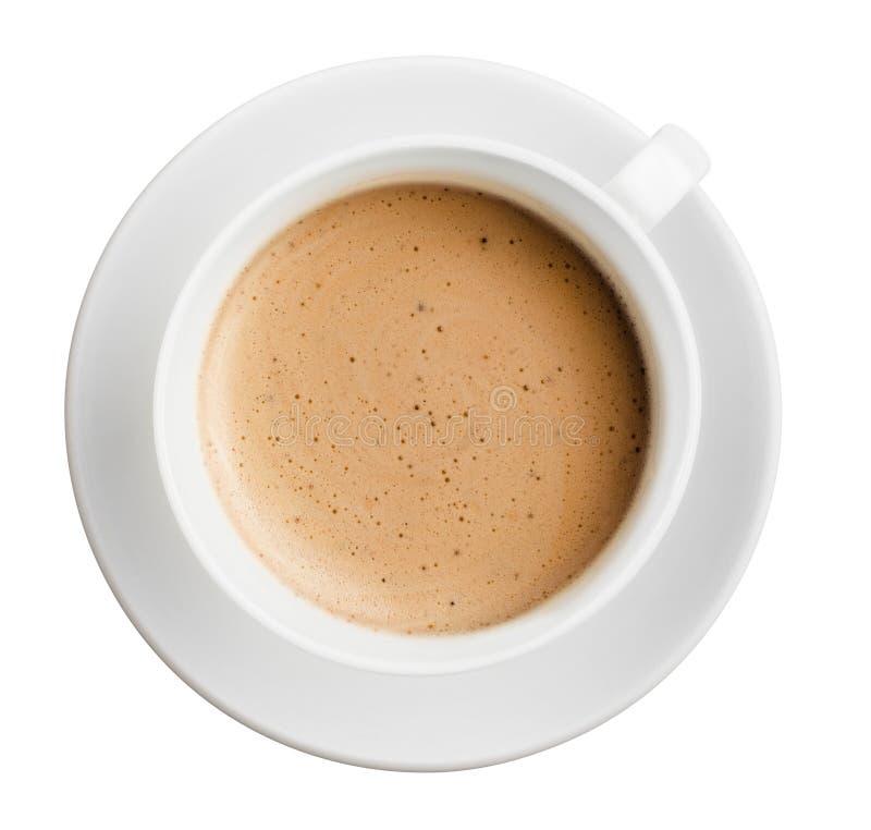 Taza de café con la espuma aislada, toda en el foco, visión superior foto de archivo