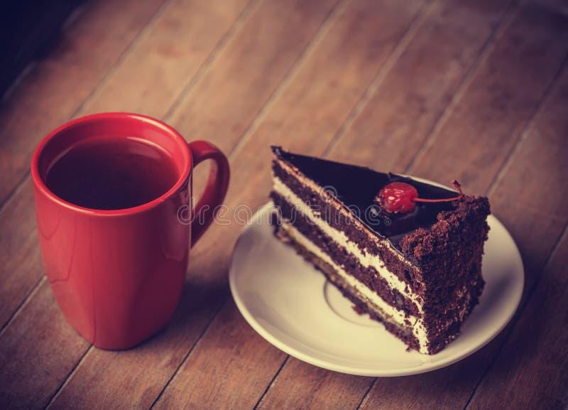 Taza de café con la torta imagen de archivo