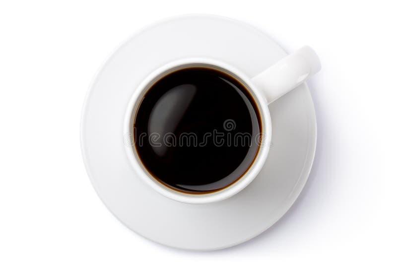 Taza de café de cerámica blanca en el platillo. Visión superior. fotos de archivo libres de regalías