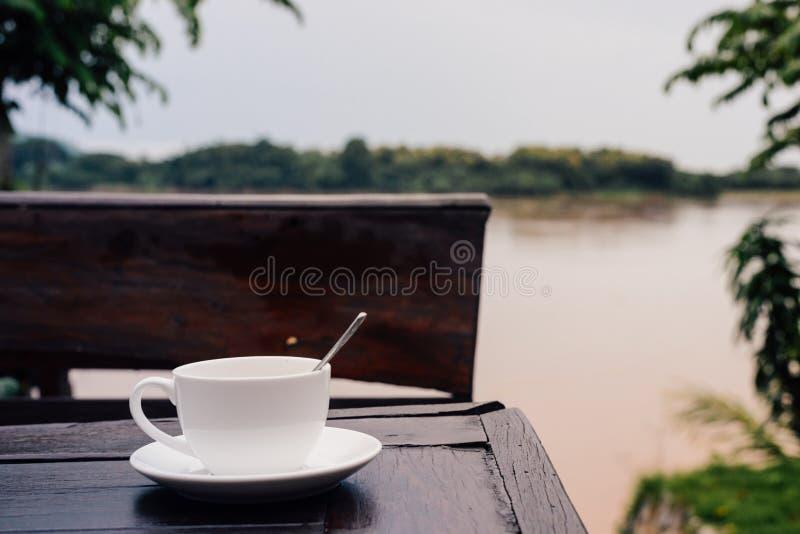 Taza de café en el vector foto de archivo