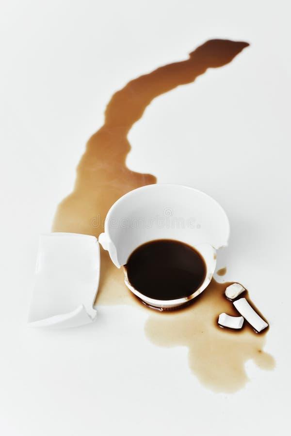 Taza de café quebrada fotografía de archivo