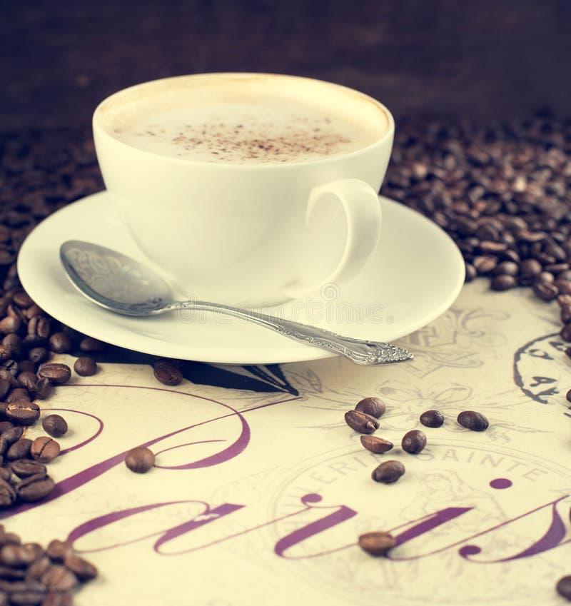 Taza de café y de granos de café. imágenes de archivo libres de regalías
