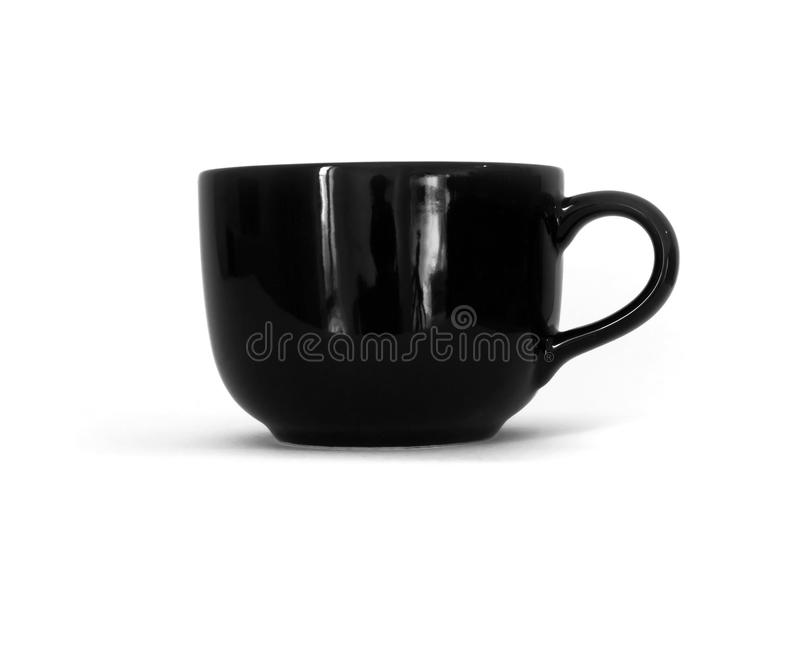 Taza de cerámica negra en el fondo blanco imagen de archivo