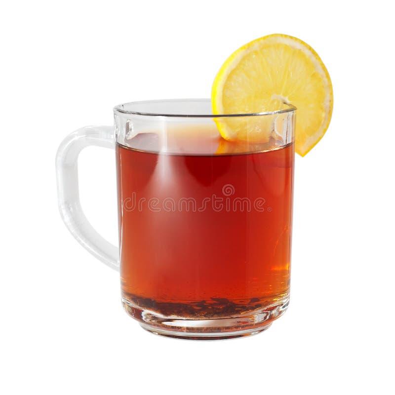 Taza de cristal con té negro y el limón fotografía de archivo
