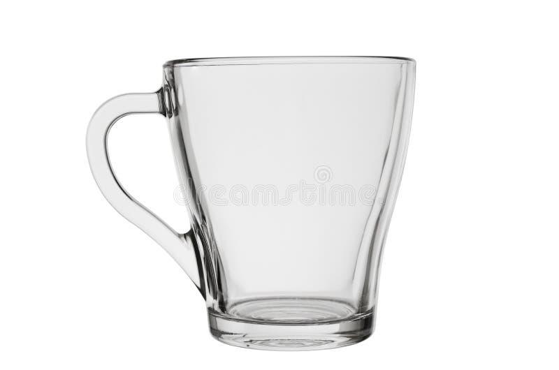 Taza de cristal vacía con la manija para el té del café u otras bebidas calientes aisladas en un fondo blanco imagen de archivo libre de regalías