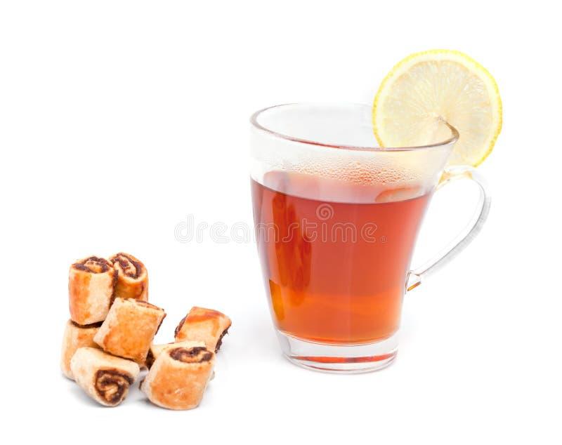 Taza de té con las galletas imagenes de archivo