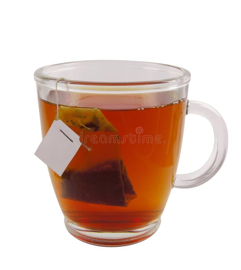 Taza de té de cristal con la bolsita de té foto de archivo libre de regalías