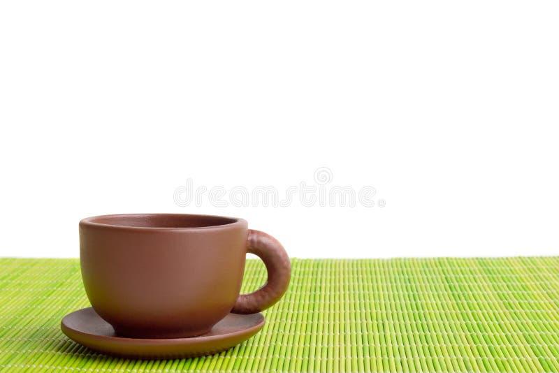 Taza de té de la arcilla fotos de archivo